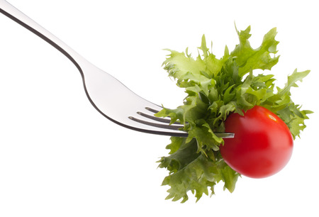 tomate cherry: Fresh salad and cherry tomato on fork isolated on white background cutout. Healthy eating concept.