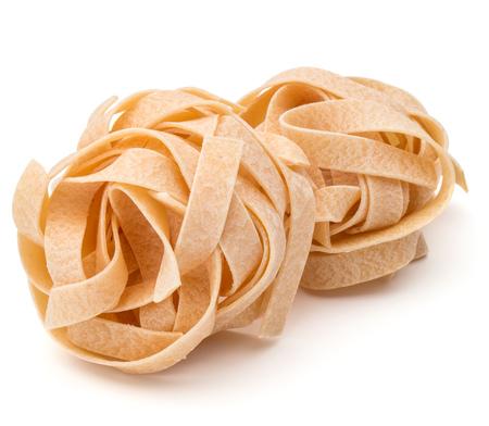 maccheroni: Italian pasta fettuccine nest isolated on white background