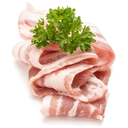 uncooked bacon: sliced bacon and parsley leaves isolated on white background cutout