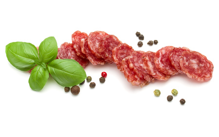 basil herb: Salami smoked sausage slices, basil leaves and peppercorns isolated on white background cutout
