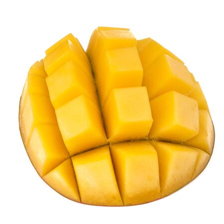 Sliced mango cubes isolated on white background