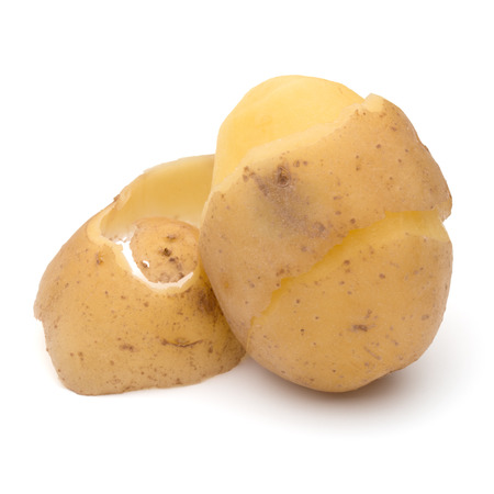 russet potato: peeled potato tuber with peel spiral isolated on white background cutout