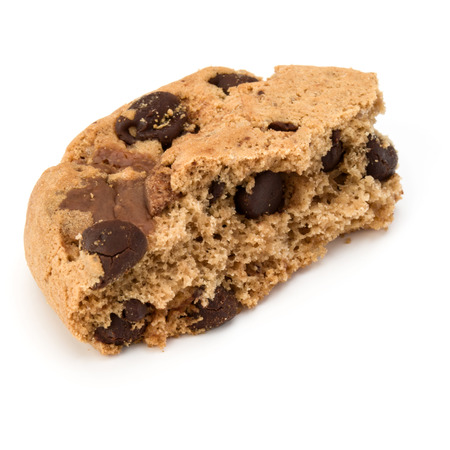 cooky: One broken Chocolate chip cookie isolated on white background. Sweet biscuit crumbs. Homemade pastry.
