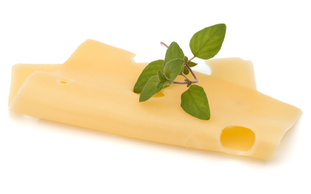 Cheese slice with oregano isolated on white background Stock Photo