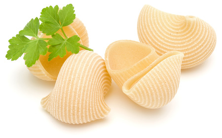 overturn: Italian lumaconi isolated on white background. Lumache, snailshell shaped pasta.