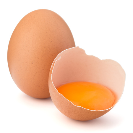 breaking: Broken egg in eggshell half and raw egg isolated on white background cutout