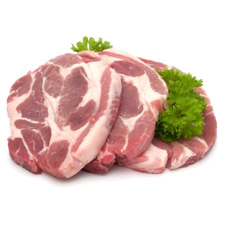Raw carne di maiale collo braciola con erba foglie di prezzemolo guarnire isolato su sfondo bianco ritaglio Archivio Fotografico - 84953364