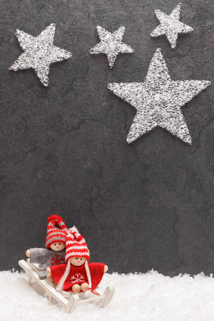 Cristmas: Christmas greeting card. Noel festive background. New year symbol. Children playing theme.