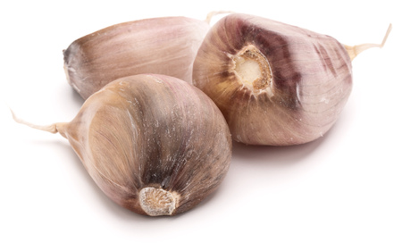 spiciness: Three garlic cloves isolated on white background cutout