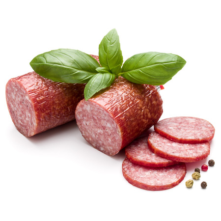 Salami smoked sausage, basil leaves and peppercorns isolated on white background Stock Photo