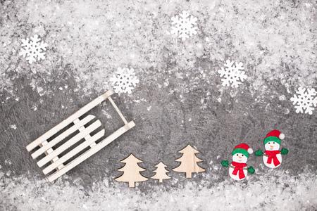 Christmas greeting card. Noel festive background. New year symbol. Sleigh. Stock Photo