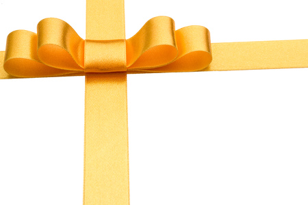 Festive golden gift ribbon and bow isolated on white background cutout Stock Photo