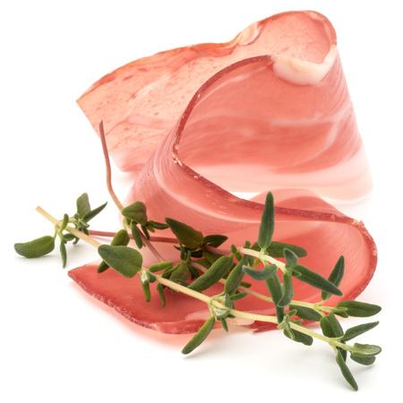 Italian prosciutto crudo or jamon. Raw ham. Isolated on white background Zdjęcie Seryjne