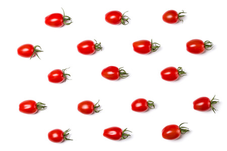 Food pattern of cherry tomato isolated on yellow background. Flat lay, top view. 写真素材