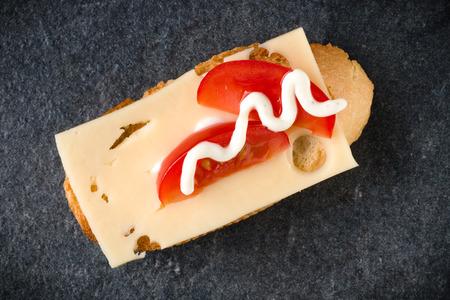 Open faced sandwich canape or crostini on dark stone background closeup. Top view. Vegetarian tartarine. Stock Photo - 115654751