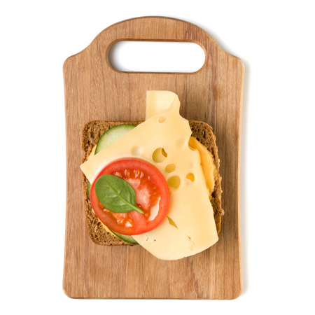 Open  faced cheese sandwich canape or crostini on a wooden serving board  isolated on white background closeup. Top view. Vegetarian tartarine. Stock Photo