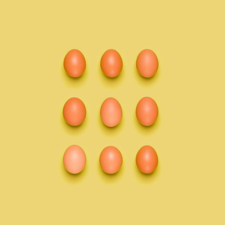 Eggs pattern on yellow background. Easter concept. Flat lay, top view. Food background.