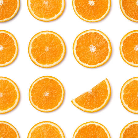 Seamless pattern of orange fruit slices. Orange slices isolated on white background. Food background. Flat lay, top view. 写真素材
