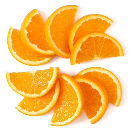 Orange fruit slice layout isolated on white background closeup. Food background. Flat lay, top view.