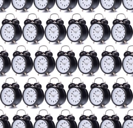 Black alarm clock isolated on white background. Seamless pattern.