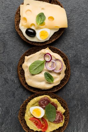 Variety of open sandwiches. Top view, flat lay.