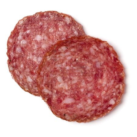Slices of salami isolated on white background closeup. Sausage top view. Фото со стока
