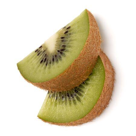 Two kiwi fruit slices isolated on white background closeup. Segment of kiwi slice,  flatlay. Flat lay, top view.