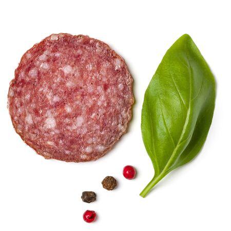 Slice of salami isolated on white background closeup. Фото со стока
