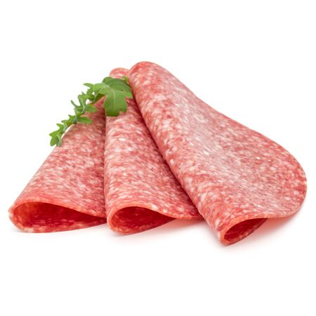 Salami smoked sausage slices isolated on white background Фото со стока