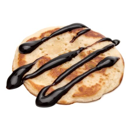 One pancake with chocolate syrup isolated on white background cutout. 版權商用圖片