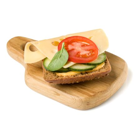 Open  faced cheese sandwich canape or crostini on a wooden serving board  isolated on white background closeup. Vegetarian tartarine.