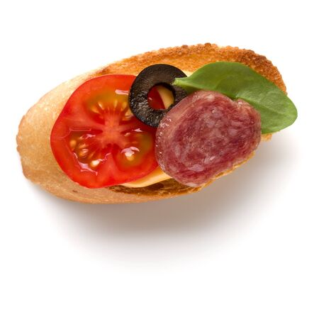 Open faced sandwich canape or crostini isolated on white background closeup. Top view. Banco de Imagens - 130163816