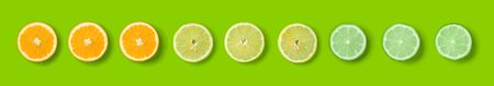 Citrus Fruit pattern on green  background. Orange, Lime, Lemon slices background. Flat lay, top view. Banner, seamless pattern, creative summer food concept.. Pop art design, creative summer concept. Panoramic fruit pattern.. Creative layout .