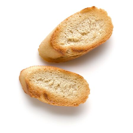 Toasted baguette slices isolated on white background close up.  Toast, crouton. Top view. Banco de Imagens