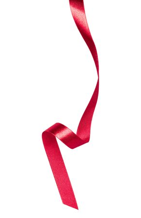 Shiny satin ribbon in red color isolated on white background close up. Ribbon image for decoration design. Stockfoto