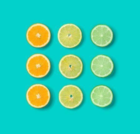 Citrus Fruit pattern on blue background. Orange, Lime, Lemon slices background. Flat lay, top view.. Pop art design, creative summer concept.. Creative layout . Stock fotó