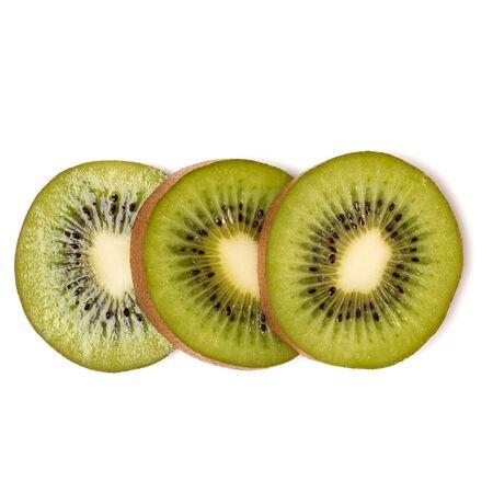 Three kiwi fruit slices isolated on white background closeup. Kiwifruit slices flatlay. Flat lay, top view.