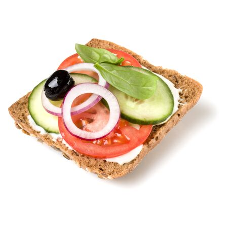 Open faced sandwich crostini isolated on white background closeup. Vegetarian canape with tomato and cucumber. Appetizer tartarine.