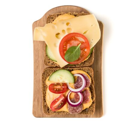 Open  faced sandwich canape or crostini on a wooden serving board  isolated on white background closeup. Top view. Stock fotó