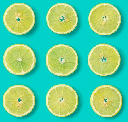 Fruit pattern of lemon slices on blue background. Flat lay, top view.. Pop art design, creative summer concept.. Creative layout .