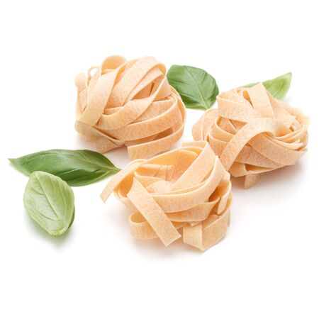 Italian pasta fettuccine nest and basil leaves  isolated on white background cutout Stock fotó