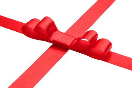 Festive red gift ribbon and bow isolated on white background cutout