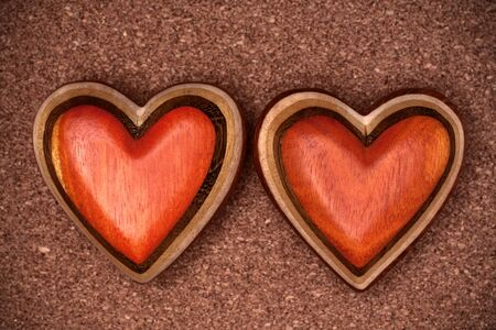 Two wooden hearts on rustic wood background. Valentines days concept.  Love symbol. Greeting card. 스톡 콘텐츠