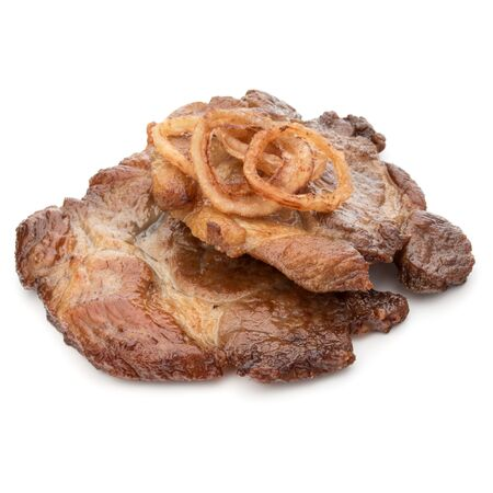 Cooked fried pork meat with onion slices garnish isolated on white background cutout