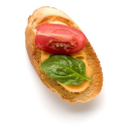 Open faced sandwich canape or crostini isolated on white background closeup. Top view. Vegetarian tartarine. Banco de Imagens - 130164290