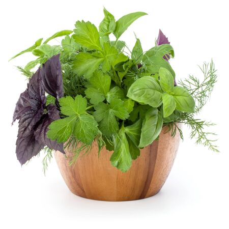 Fresh spices and herbs in wicker basket isolated on white background cutout. Sweet basil, red basil leaves, dill and parsley. Stockfoto