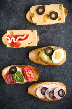 Open faced sandwich canape or crostini on dark stone