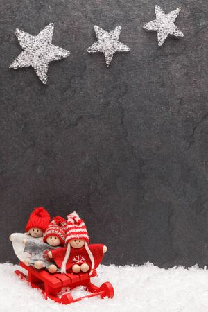 Christmas greeting card design on grey Standard-Bild