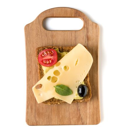 Open  faced cheese sandwich canape or crostini on a wooden serving board  isolated on white
