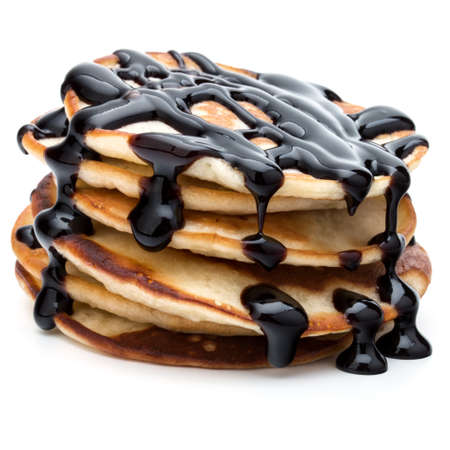 Pancakes stack with chocolate syrup on white background Stockfoto